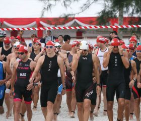 IMB15_Swim_Age-Groupers-Walking-to-the-Sea_Elite